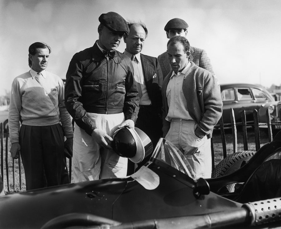 Mike Hawthorn, Raymond Mays and Stirling Moss discuss the prospects of the BRM before the start of racing at Goodwood
