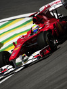 Felipe Massa clips the apex in his Ferrari