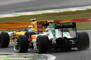 Adrian Sutil tries to find a way past Vitaly Petrov