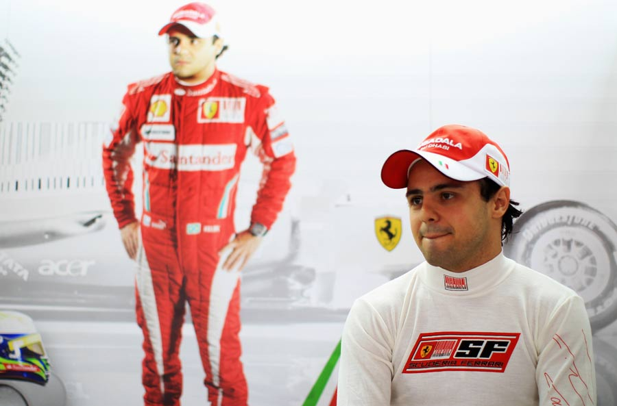 Felipe Massa sits in the shadow of his portrait