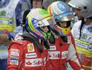 Fernando Alonso and Felipe Massa walk off together