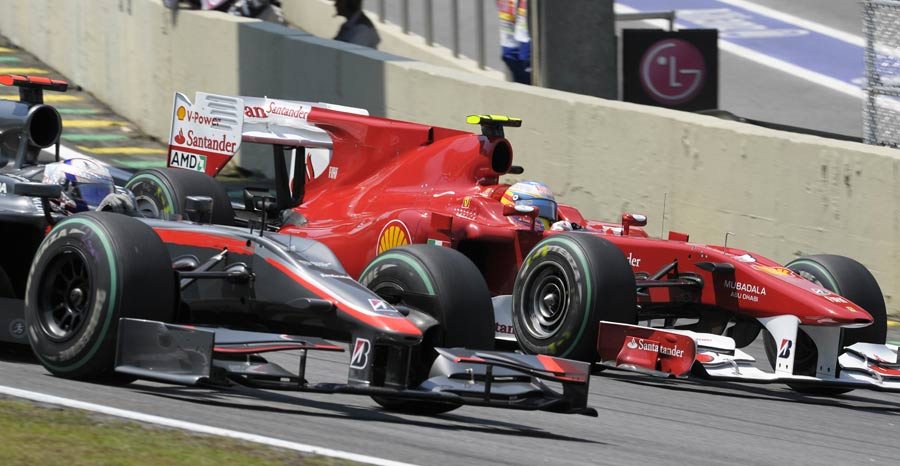Fernando Alonso laps Christian Klien