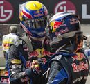 Mark Webber and Sebastian Vettel celebrate winning the constructors' title for Red Bull after the team's 1-2 finish