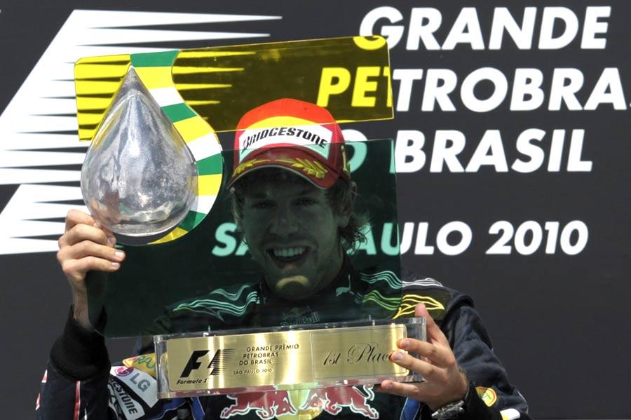 Sebastian Vettel with his winner's trophy