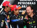 Mark Webber and Sebastian Vettel celebrate with Red Bull boss Christian Horner on the podium
