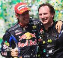 Sebastian Vettel celebrates with Red Bull boss Christian Horner