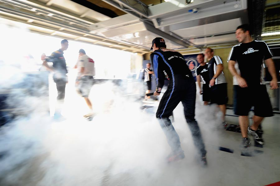 Mark Webber sprays a fire extinguisher in the garage