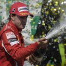 Fernando Alonso sprays champagne on the podium