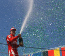 Fernando Alonso celebrates his podium finish