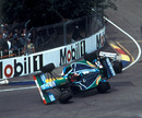 Michael Schumacher's Benetton is launched into the air after making contact with Damon Hill
