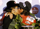 Emerson Fittipaldi celebrates his second world championship title on the podium with wife Maria-Helena