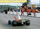 Emerson Fittipaldi wins in front of his McLaren pit crew