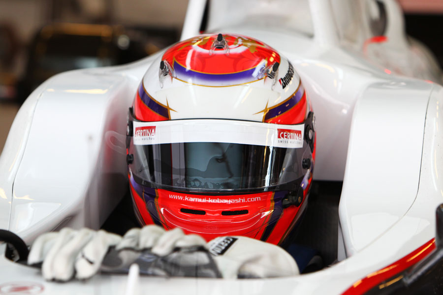 Kamui Kobayashi sits in his Sauber cockpit ahead of the morning's action