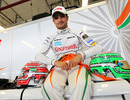 Tonio Liuzzi poses for a photograph in the Force India garage