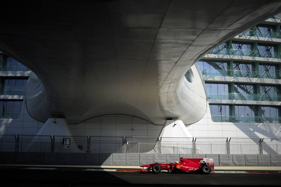 Felipe Massa passes beneath the Yas Hotel bridge