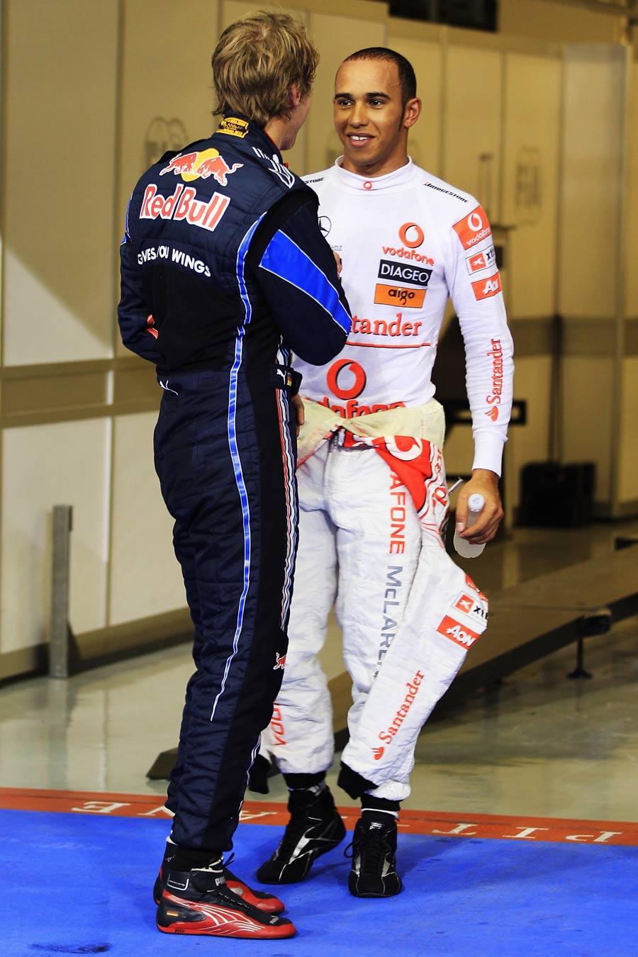 Lewis Hamilton congratulates Sebastian Vettel on his pole position