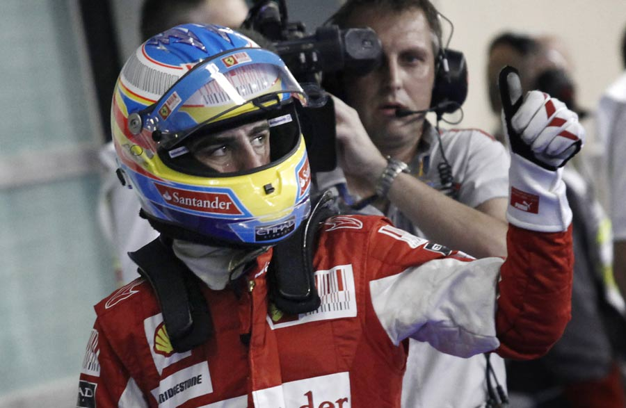 Fernando Alonso gives the thumbs up after qualifying third