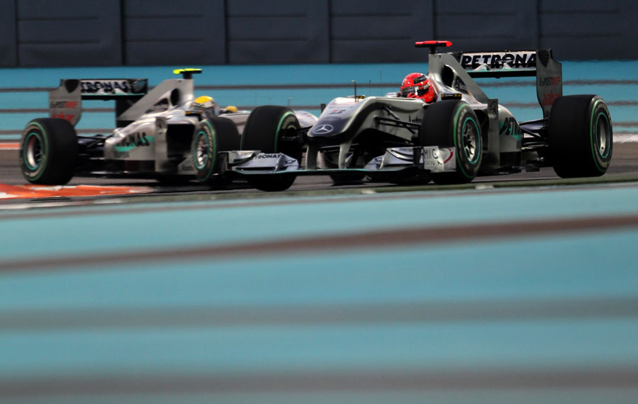 Michael Schumacher leads Nico Rosberg during qualifying