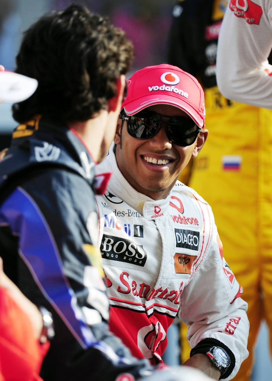 Lewis Hamilton shares a joke with Mark Webber