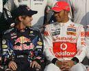 Lewis Hamilton shares a joke with Sebastian Vettel