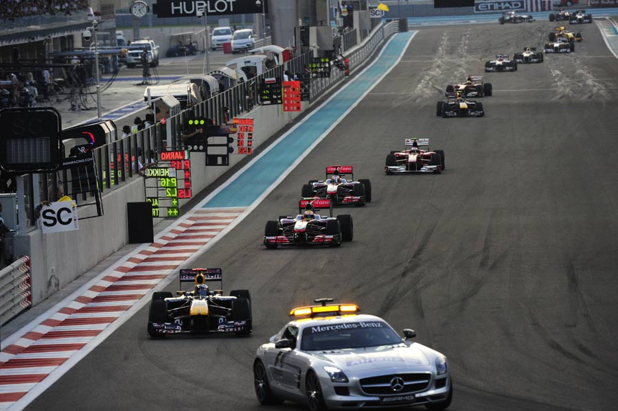 The field follows the safety car