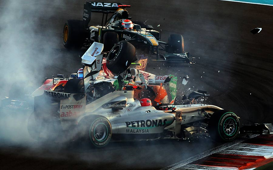 Tonio Liuzzi ploughs into Michael Schumacher's Mercedes