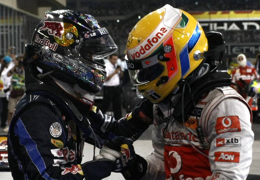 Lewis Hamilton congratulates Sebastian Vettel on winning the drivers' title