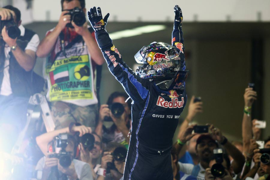 Sebastian Vettel celebrates his title victory in front of the world's media