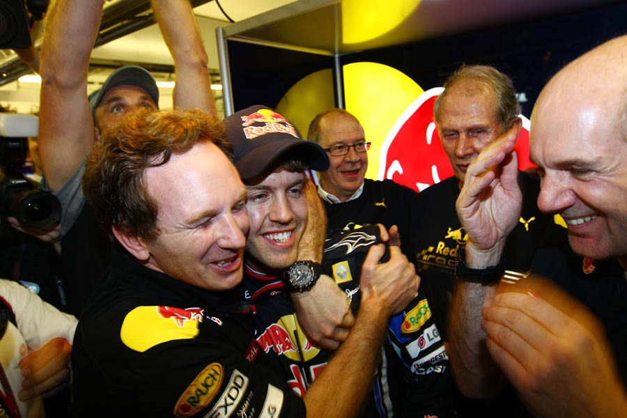 Red Bull boss Christian Horner celebrates with Sebastian Vettel