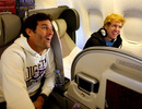 Mark Webber and Sebastian Vettel share a joke on the plane home