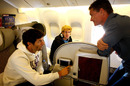 David Coulthard talks to Mark Webber and Sebastian Vettel on the plane home