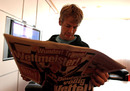 Sebastian Vettel catches up on the news on his return to Austria
