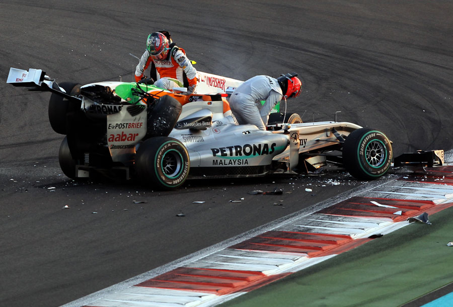 Tonio Liuzzi and Michael Schumacher get out of their cars