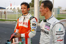 Tonio Liuzzi and Michael Schumacher chat in the paddock after their accidents