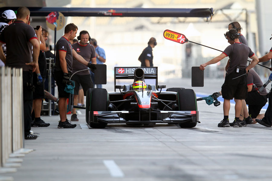 Pastor Maldonado practices a pit stop in the HRT