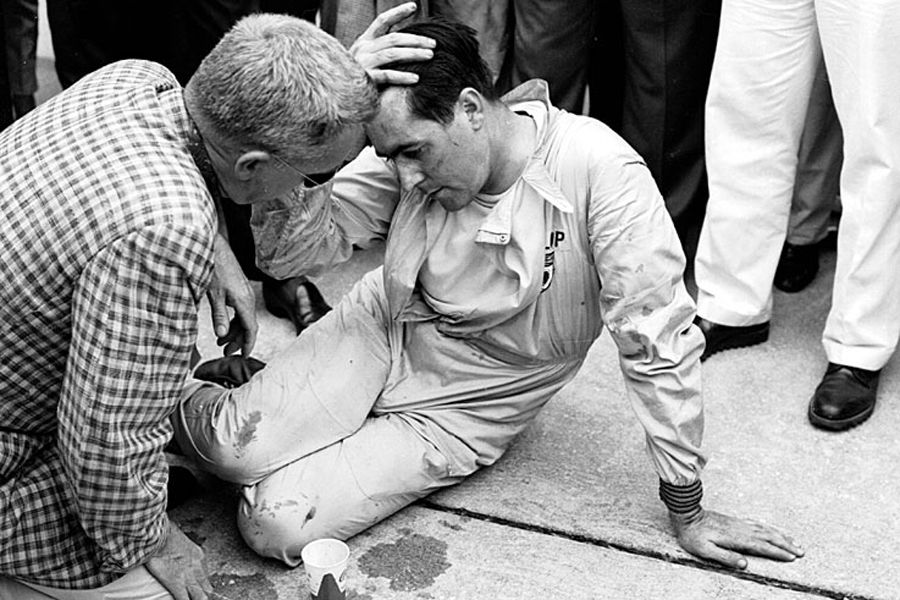 An exhausted Jack Brabham after pushing his car over the line to secure his first world championship