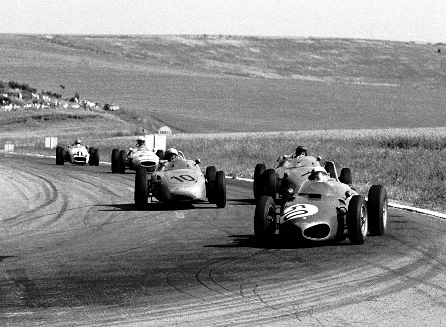 Giancarlo Baghetti in a Ferrari 156 leads the Porsches 718 of Dan Gurney  and Jo Bonnier on his way to victory at the French GP