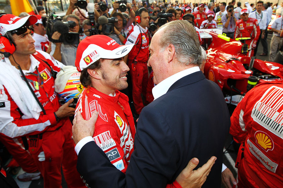 King Carlos of Spain greets Fernando Alonso on the grid