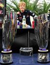 Sebastian Vettel in front of his winners' trophies at Hanger 7 in Salzburg