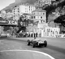 Sir Stirling Moss on his way to victory in a Rob Walker Lotus 18, the first win for the Lotus marque