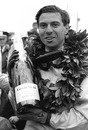 Jim Clark celebrates after he won the Grand Prix of the United States