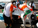 Adrian Sutil points out a problem after his car stopped on track