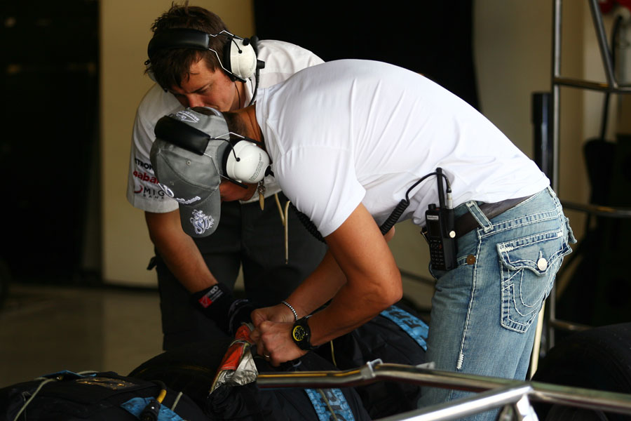 Michael Schumacher keeps a close eye on the performance of the new Pirelli tyres