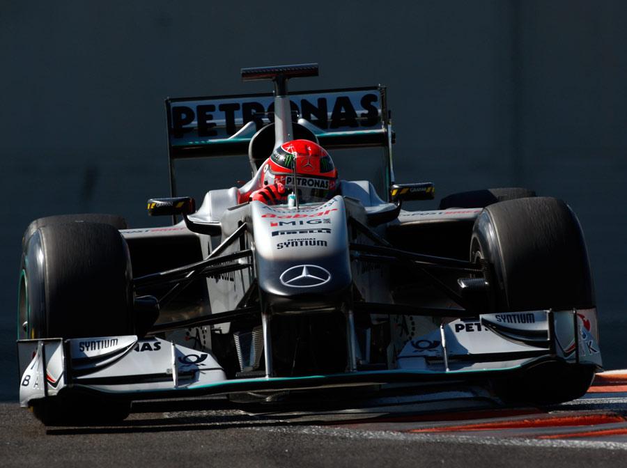 Michael Schumacher takes a curb
