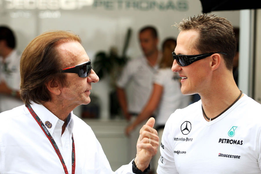 Emerson Fittipaldi chats with Michael Schumacher