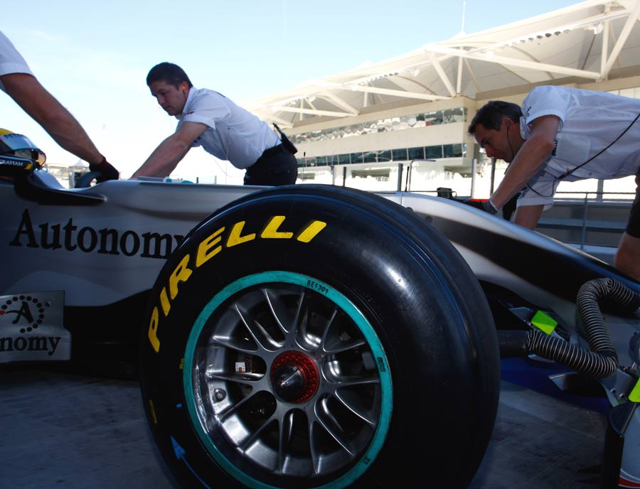 Nico Rosberg is wheeled back to the pits during the Abu Dhabi Pirelli test