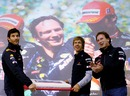 Sebastian Vettel and Mark Webber give a birthday cake to team principal Christian Horner