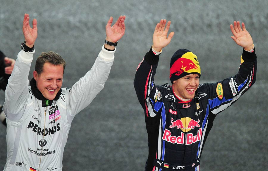 Michael Schumacher and Sebastian Vettel celebrate