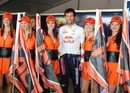 Mark Webber poses with grid girls