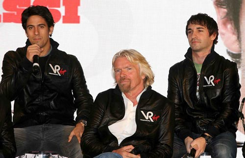 Virgin Racing team-mates Lucas di Grassi and Timo Glock pose with Sir Richard Branson
